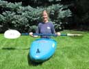 Picture of Mandy Kotzman balanced in a whitewater kayak, ready to flip